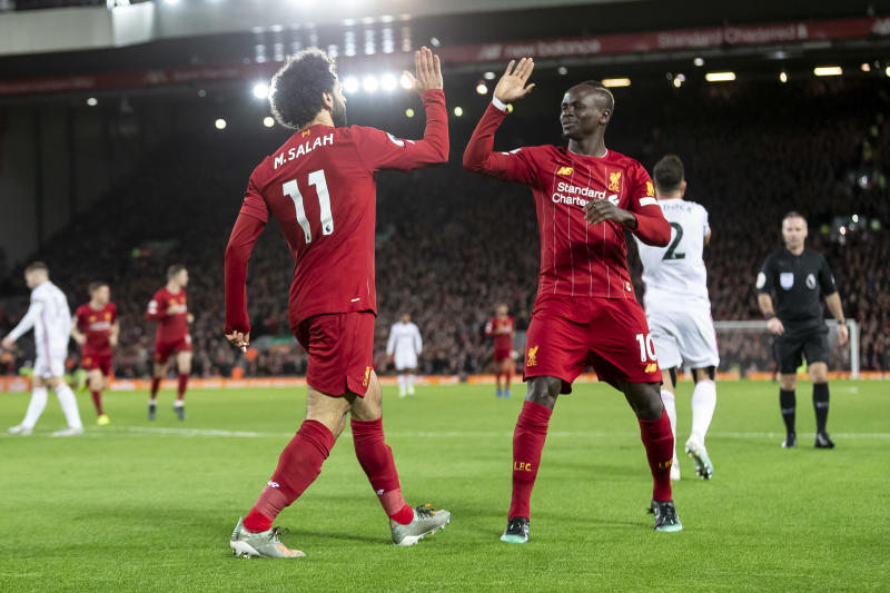LIVERPOOL, ENGLAND - JANUARY 02: Mohamed Salah of Liverpool celebrates with Sadio Mane of Liverpool after scoring their first goal to make the score 1-0 during the Premier League match between Liverpool FC and Sheffield United at Anfield on January 2, 2020 in Liverpool, United Kingdom. (Photo by Daniel Chesterton/Offside/Offside via Getty Images)