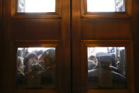 FILE - In this Jan. 6, 2021, file photo, U.S. Capitol Police try to hold back rioters outside the east doors to the House side of the U.S. Capitol, Wednesday, Jan 6, 2021. (AP Photo/Andrew Harnik)