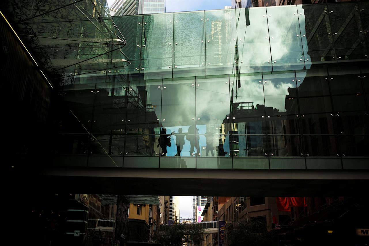 "A family walks across a glass-enclosed bridge between two shopping malls in central Sydney, Australia, August 4, 2016.     REUTERS/Jason Reed/File Photo                     GLOBAL BUSINESS WEEK AHEAD - SEARCH ""GLOBAL BUSINESS AUG 29"" FOR ALL IMAGES?"