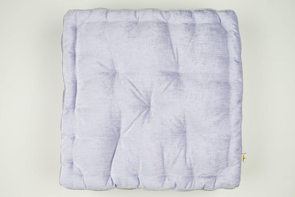 <p>This soft lavender <span>Disney Princess X POPSUGAR Tiana Chenille Floor Pillow</span> ($30) is made for lounging.</p>