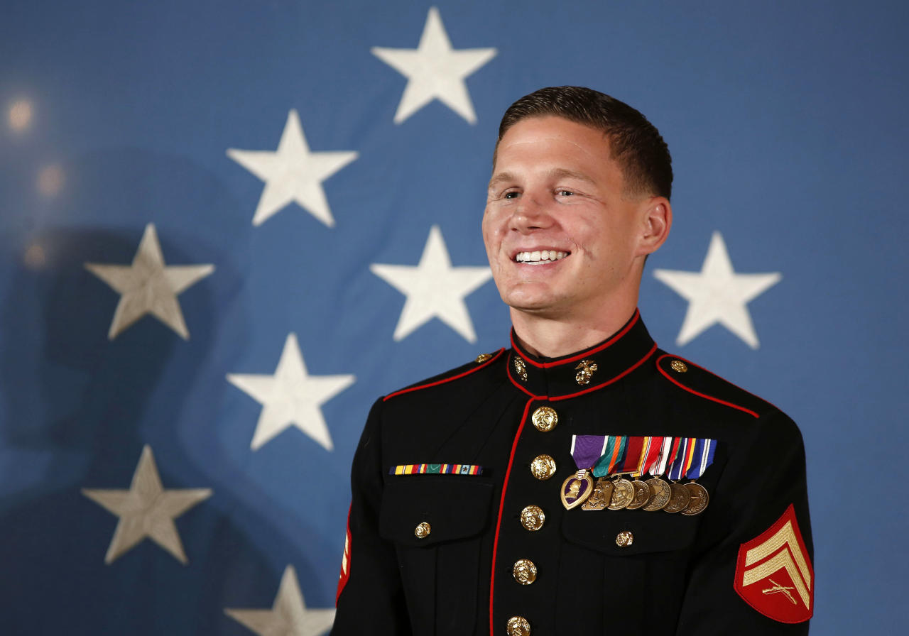 "Retired U.S. Marine Corps Corporal William ""Kyle"" Carpenter stands before receiving the Medal of Honor from U.S. President Barack Obama during a ceremony in the East Room of the White House in Washington, June 19, 2014. Carpenter received the award for ""conspicuous gallantry"" performed while serving in Helmand Province, Afghanistan. REUTERS/Larry Downing (UNITED STATES - Tags: POLITICS MILITARY PROFILE)"