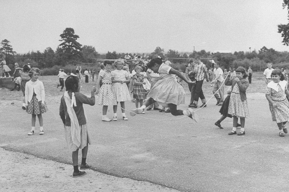 <p>Elementary school students take turns jumping rope during recess. </p>