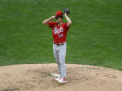 Cincinnati Reds pitcher Sonny Gray adjusts his cap while throwing against the Minnesota Twins during the first inning of a baseball game Sunday, Sept. 27, 2020, in Minneapolis. (AP Photo/Craig Lassig)