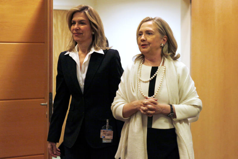 U.S. Secretary of State Hillary Rodham Clinton, right, walks to a NATO Russia Council Meeting at NATO Headquarters in Brussels, Belgium, on Thursday, April 19, 2012. (AP Photo/Jacquelyn Martin, Pool)