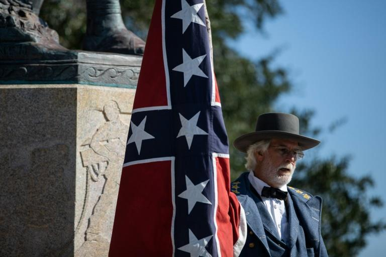 "Braxton Spivey describes himself as a ""living historian"" who supports display of the Confederate battle flag as a way to honor souther Civil War soldiers, but critics call him racist"