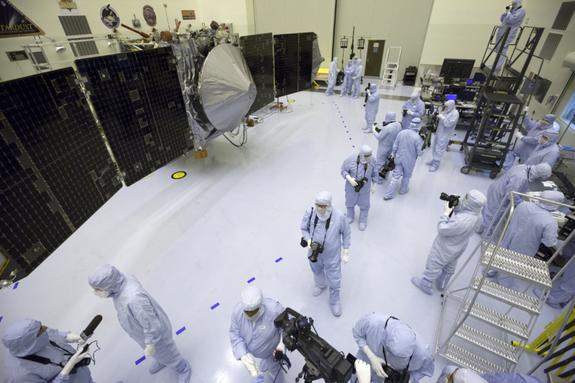 Inside the Payload Hazardous Servicing Facility at NASA's Kennedy Space Center in Florida, reporters and photographers look over the Mars Atmosphere and Volatile Evolution, or MAVEN, spacecraft on Sept. 27, 2013. The Mars orbiter is due to laun