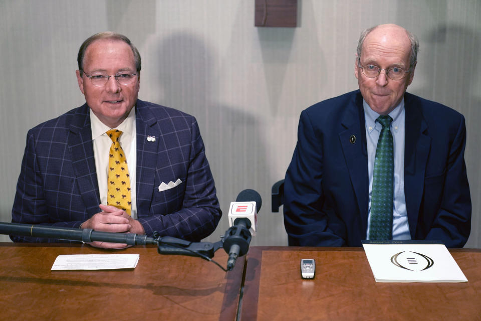 College Football Playoff Executive Director Bill Hancock, right, and Mark Keenum, Mississippi State president and chairman of the CFP presidents group listen to a reporter's question Tuesday, June 22, 2021, in Grapevine, Texas. The CFP met to discuss a proposed plan to expand the postseason format from four to 12 teams. (AP Photo/LM Otero)