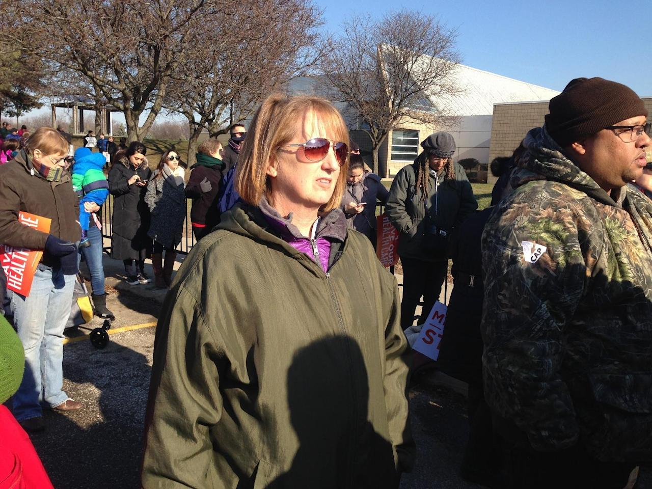 Lisa Bible is one of thousands supporters of the Affordable Care Act who turned out Sunday, Jan. 15, 2016, in Warren, Mich., to hear Democratic U.S. Sen. Bernie Sanders speak against Republican efforts to repeal the law. Bible has her health insurance through the law and worries that she may not be able to afford medical treatment if it's repealed. (AP Photo/Corey Williams)