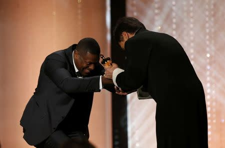 Actor Chris Tucker present Jackie Chan (R) with his Honorary Award at the 8th Annual Governors Awards in Los Angeles, California, U.S., November 12, 2016.  REUTERS/Mario Anzuoni