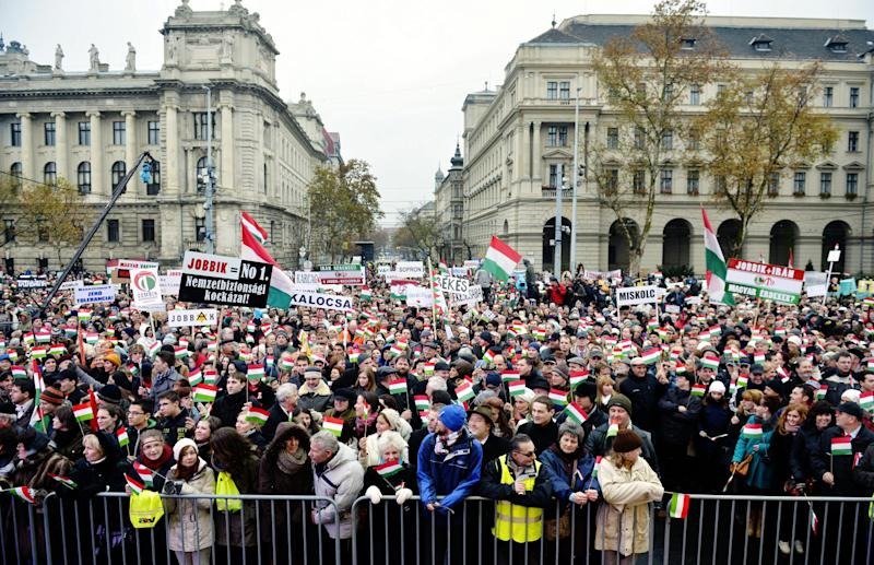 Thousands of people attend a protest called Mass Demonstration Against Nazism, in front of the Parliament building, unseen, in Budapest, Hungary, Sunday, Dec. 2, 2012. The protest has been provoked by MP of Jobbik party Marton Gyongyosi who demanded a list on Jewish Hungarians who are members of the Parliament or the government. (AP Photo/MTI, Laszlo Beliczay)