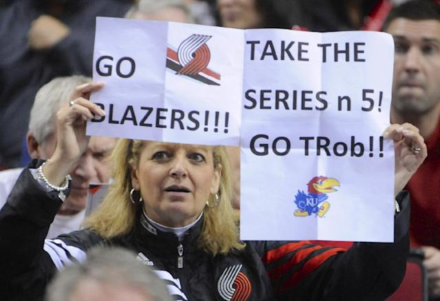 Portland Trail Blazers' supporter Brenda Mills holds up her sign during the first half of game four of an NBA basketball first-round playoff series game against the Houston Rockets in Portland, Ore., Sunday March 30, 2014. (AP Photo/Greg Wahl-Stephens)