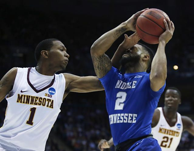 <p>Middle Tennessee State's Antwain Johnson (2) is hit in the face as he drives past Minnesota's Dupree McBrayer (1) during the first half of an NCAA college basketball tournament first round game Thursday, March 16, 2017, in Milwaukee. (AP Photo/Kiichiro Sato) </p>