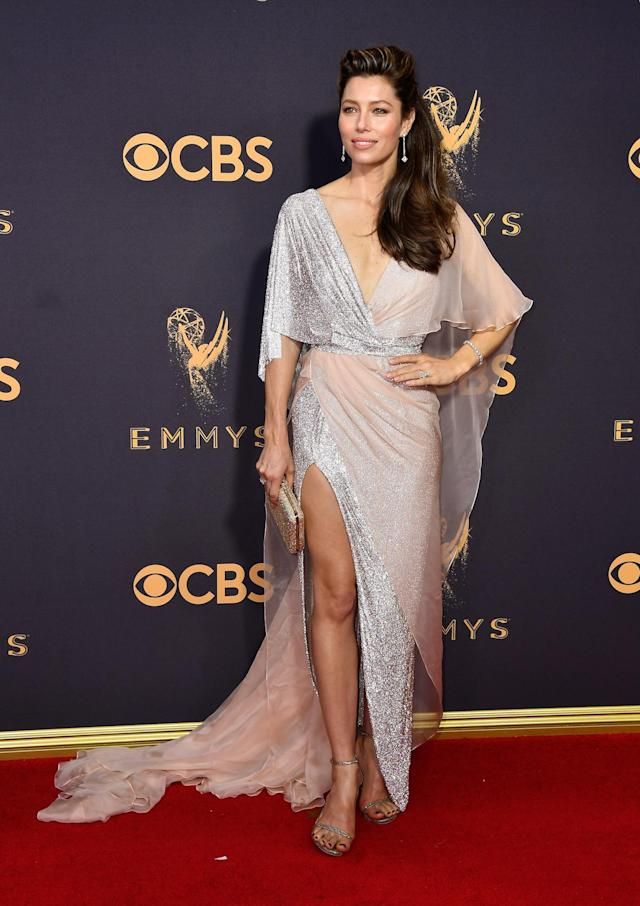 <p>Biel's gown combined delicate chiffon and flashy sequins. She balanced the look, featuring a deep V-neck and high leg slit, with a side-part half-down style. (Photo: Getty Images) </p>