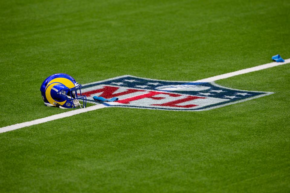 A Rams helmet sits next to NFL Logo at the Los Angeles Rams scrimmage. (Photo by Jevone Moore/Icon Sportswire via Getty Images)
