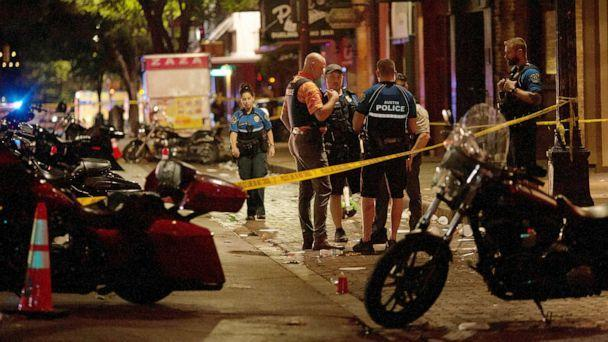 PHOTO: Police investigate the scene of a mass shooting in the Sixth Street entertainment district area of Austin, Texas, June 12, 2021. (Nuri Vallbona/Reuters)