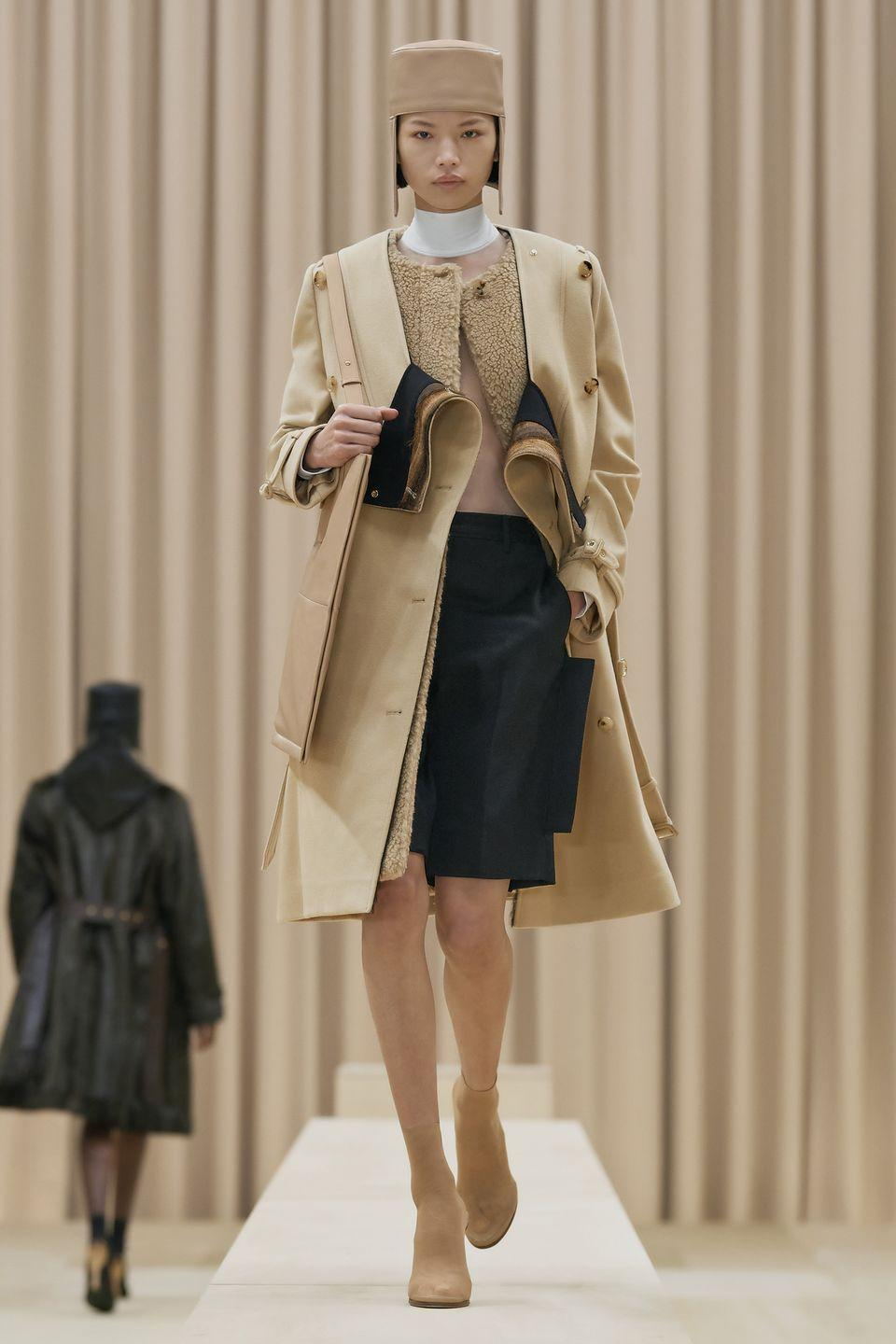 """<p>Burberry Chief Creative Officer Ricardo Tisci's Fall 2021 collection is an exposition on feminine strength. """"I wanted this collection to feel truly emblematic of the power of feminine energy: a modern armor that captures its characteristic fierce aura,"""" he explained in his show notes. """"There's an underlying attitude to the collection that's very British; of being unique, eccentric and totally authentic in how you express yourself.""""</p><p>In Tisci's accomplished hands armor doesn't have to mean something stiff and structured. It could be a sharp-shouldered boxy blazer or gleaming gold lamé trench coat, just as easily as it could a fluttering cape-sleeve dress in color block and animal print or a fluid unlined cape. The majority of these options came paired with quirky sock boots with eye-catching sculptural heels and soles moulded to resemble deer hooves, giving the models a soft, doe-like stride. For Tisci's modern day Boudicas, armor is anything that gives you the confidence to awaken from our extended hibernation and reenter the world of fashion. <em>—Alison S. Cohn<br></em><br><br><br></p>"""
