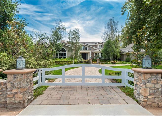 """<p>Denise Richards is asking about $7.3 million for this Hidden Hills home, a price cut of nearly half a million from last year. While the home looks like your fairly standard suburban Los Angeles fare, it's really not … at least not anymore. First, we'll look at the evolution of the front exterior. (Photo via <a href=""""http://bit.ly/1VbyH0q"""" target=""""_blank"""">Marc & Rory Shevin listing</a>)</p>"""