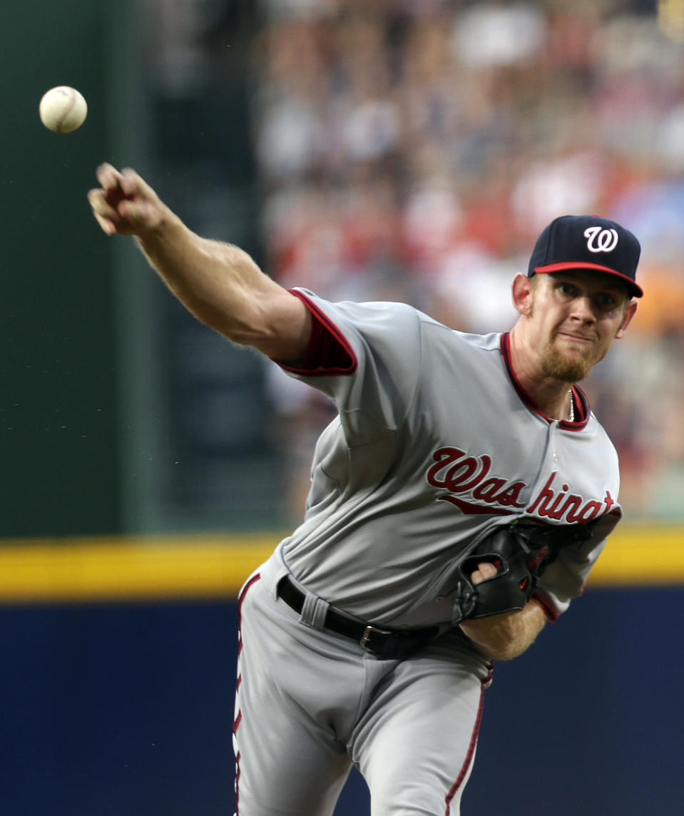 Washington Nationals starting pitcher Stephen Strasburg throws in the first inning of a baseball game against the Atlanta Braves in Atlanta, Friday, May 31, 2013. (AP Photo/John Bazemore)