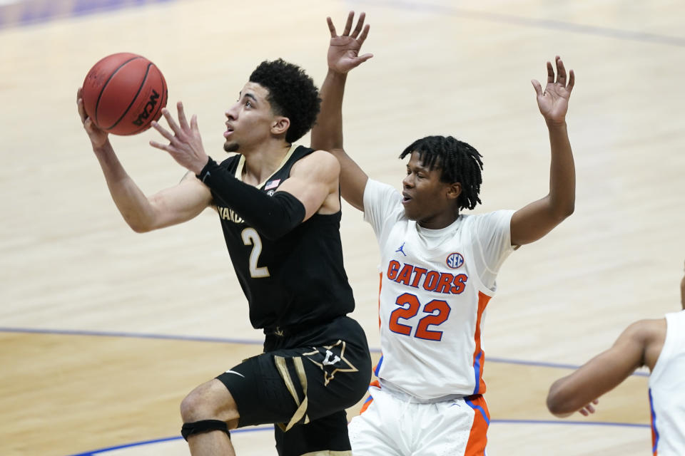 Vanderbilt's Scotty Pippen Jr. (2) drives against Florida's Tyree Appleby (22) in the second half of an NCAA college basketball game in the Southeastern Conference Tournament Thursday, March 11, 2021, in Nashville, Tenn. (AP Photo/Mark Humphrey)