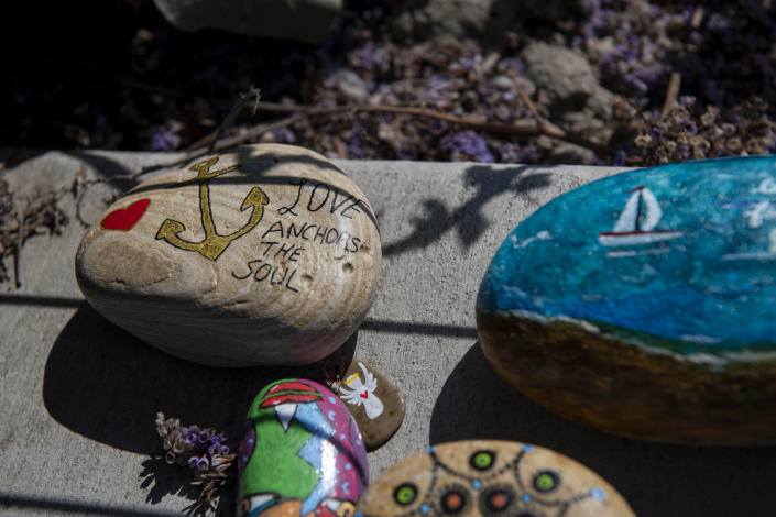 Handcrafted mementos in memory of those who lost their lives in the fire on the dive boat Conception are placed at a memorial for the victims on the Santa Barbara Harbor on Wednesday, Sept. 4, 2019, in Santa Barbara, Calif. A fire raged through the boat carrying recreational scuba divers anchored near an island off the Southern California Coast Monday, leaving multiple people dead. (AP Photo/Christian Monterrosa )