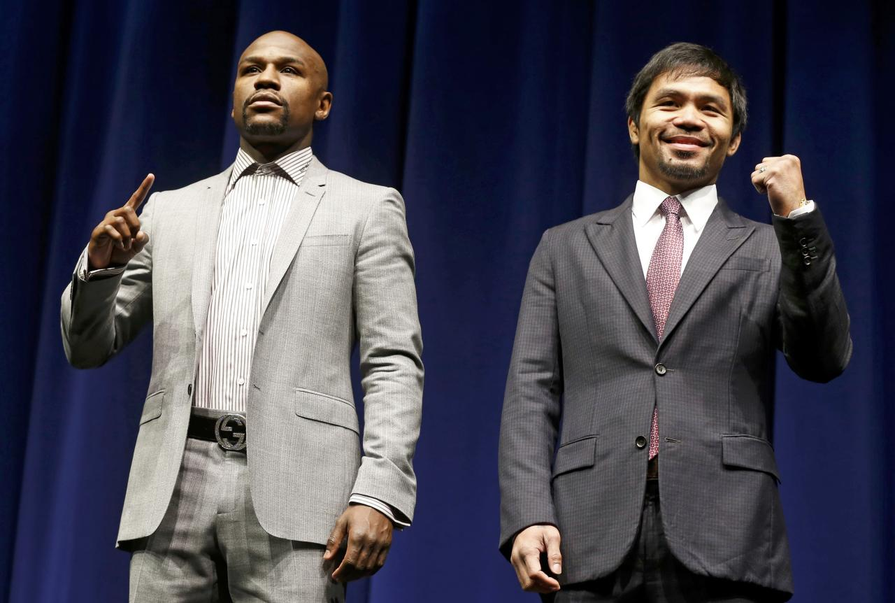 """Eleven-time, five-division world boxing champion Floyd """"Money"""" Mayweather (L) and eight-division world champion Manny """"Pac-Man"""" Pacquiao attend a press conference  in Los Angeles, California March 11, 2015.    REUTERS/Lucy Nicholson (UNITED STATES  - Tags: SPORT BOXING PROFILE ENTERTAINMENT)"""