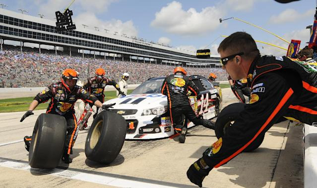 Tony Stewart pits during the NASCAR Sprint Cup series auto race at Texas Motor Speedway Monday, April 7, 2014, in Fort Worth, Texas. (AP Photo/Ralph Lauer)