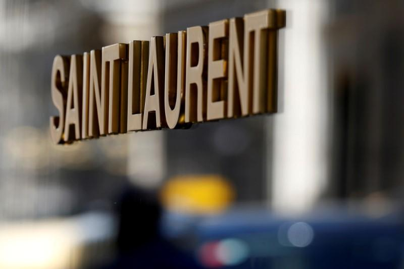 FILE PHOTO: The logo of Saint Laurent, a brand of French luxury group Kering, is seen in Paris