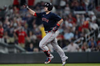 Boston Red Sox's Christian Arroyo (39) gestures as he rounds the bases after hitting a grand slam during the seventh inning of the team's baseball game against the Atlanta Braves on Wednesday, June 16, 2021, in Atlanta. (AP Photo/John Bazemore)