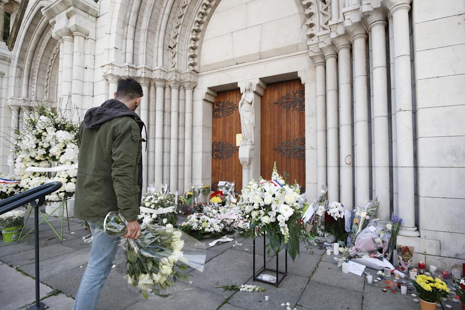 A makeshift memorial to the victims of the knife attack at the entrance of the Notre Dame Basilica church in Nice, France. Source: AAP