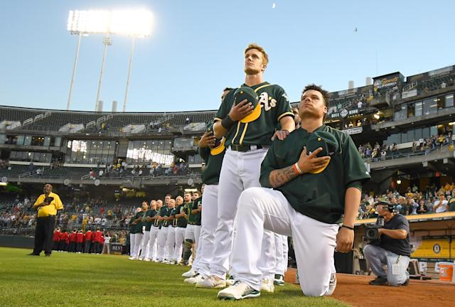 Oakland Athletics outfielder Mark Canha stood in support of teammate Bruce Maxwell when he knelt during the national anthem in 2017 to protest racial inequality and police brutality. (Photo by Thearon W. Henderson/Getty Images)