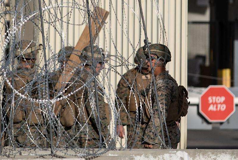 Military personnel have installed cement barriers and barbed-wire fencing at two border crossings from Tijuana into California (AFP Photo/GUILLERMO ARIAS)