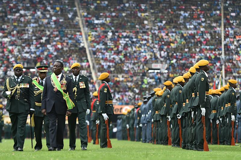 Zimbabwe's new interim president, Emmerson Mnangagwa, performs his first inspection of the Guard of Honour after he is officially sworn in on Nov. 24, 2017. (TONY KARUMBA/Getty Images)