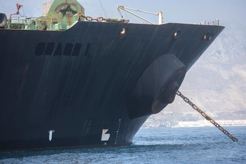 """A view of the Grace 1 super tanker with the name removed is seen in the British territory of Gibraltar, Saturday, Aug. 17, 2019. The shipping agent for an Iranian supertanker caught in a diplomatic standoff says the vessel is ready to depart Gibraltar in """"24 to 48 hours,"""" despite a last-minute effort by the United States to seize it again. (AP Photo/Marcos Moreno)"""