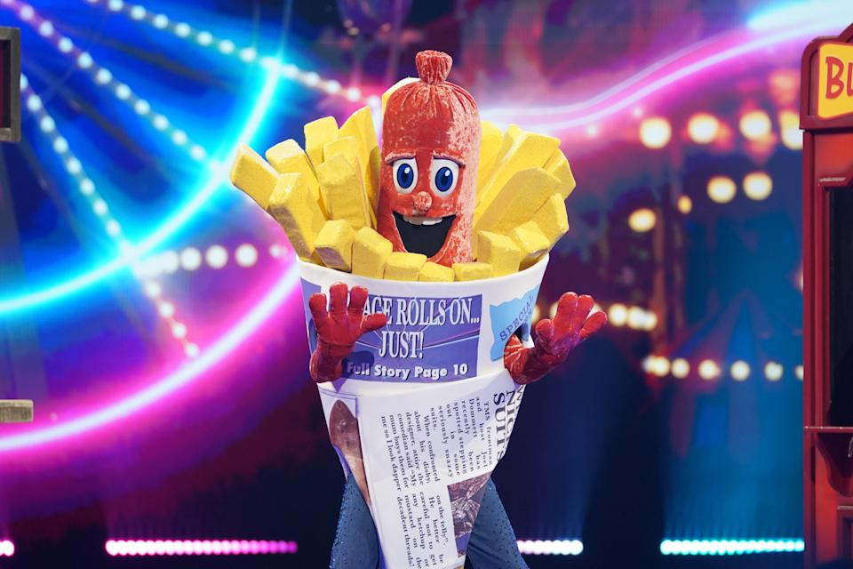 This image and the information contained herein is strictly embargoed until 00.01 Saturday 23rd January 2021  From Bandicoot TV  The Masked Singer: SR2: Ep5 on ITV  Pictured: Sausage.  This photograph is (C) Bandicoot TV and can only be reproduced for editorial purposes directly in connection with the programme or event mentioned above, or ITV plc. Once made available by ITV plc Picture Desk, this photograph can be reproduced once only up until the transmission [TX] date and no reproduction fee will be charged. Any subsequent usage may incur a fee. This photograph must not be manipulated [excluding basic cropping] in a manner which alters the visual appearance of the person photographed deemed detrimental or inappropriate by ITV plc Picture Desk.  This photograph must not be syndicated to any other company, publication or website, or permanently archived, without the express written permission of ITV Picture Desk. Full Terms and conditions are available on the website www.itv.com/presscentre/itvpictures/terms  For further information please contact: james.hilder@itv.com / 0207 157 3052