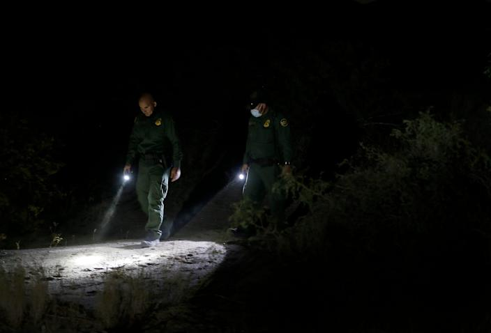 Border Patrol agents track subjects thought the desert Thursday, Oct. 8, 2020, in Sunland Park, New Mexico.