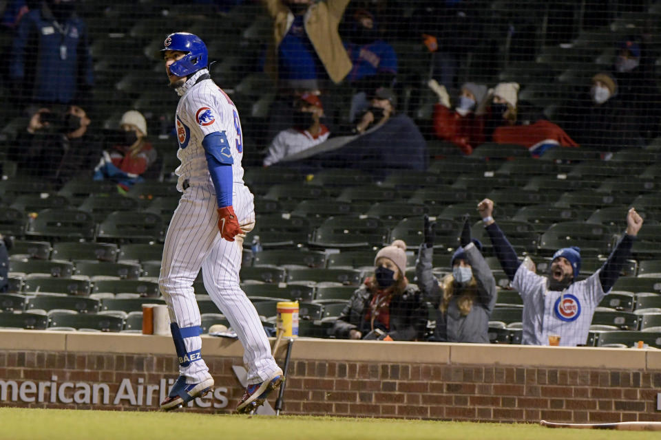 Chicago Cubs Javier Baez (9) watches his grand slam home run fly into the stands against the New York Mets during the sixth inning of a baseball game Wednesday, April 21, 2021, in Chicago. (AP Photo/Mark Black)