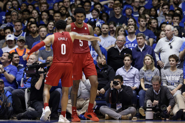 Louisville guard Lamarr Kimble (0) and forward Malik Williams (5) celebrate at the end of the team's NCAA college basketball game against Duke in Durham, N.C., Saturday, Jan. 18, 2020. Louisville won 79-73. (AP Photo/Gerry Broome)