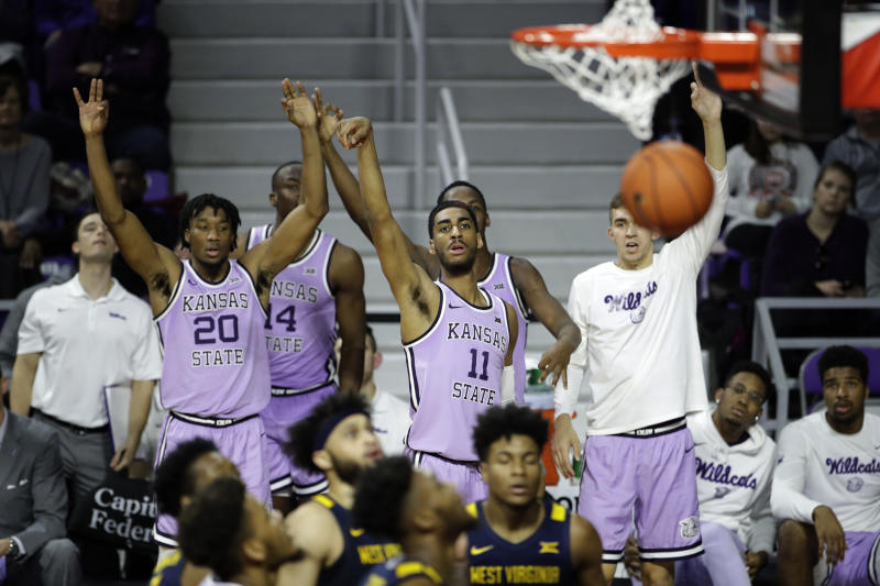 Kansas State's Antonio Gordon (11) watches his 3-point shot during the second half of an NCAA college basketball game against West Virginia Saturday, Jan. 18, 2020 in Lawrence, Kan. Kansas State won 84-68. (AP Photo/Charlie Riedel)