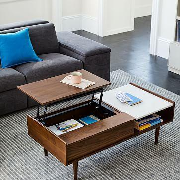 """<p><strong>West Elm</strong></p><p>westelm.com</p><p><a href=""""https://go.redirectingat.com?id=74968X1596630&url=https%3A%2F%2Fwww.westelm.com%2Fproducts%2Fmid-century-pop-up-storage-coffee-table-h1903&sref=https%3A%2F%2Fwww.goodhousekeeping.com%2Flife%2Fmoney%2Fg34415742%2Fwest-elm-warehouse-sale-october-2020%2F"""" rel=""""nofollow noopener"""" target=""""_blank"""" data-ylk=""""slk:Shop Now"""" class=""""link rapid-noclick-resp"""">Shop Now</a></p><p><strong><del>$699</del> $629.10 (10% off)</strong></p><p>Looking for a piece of furniture that can do </p>"""