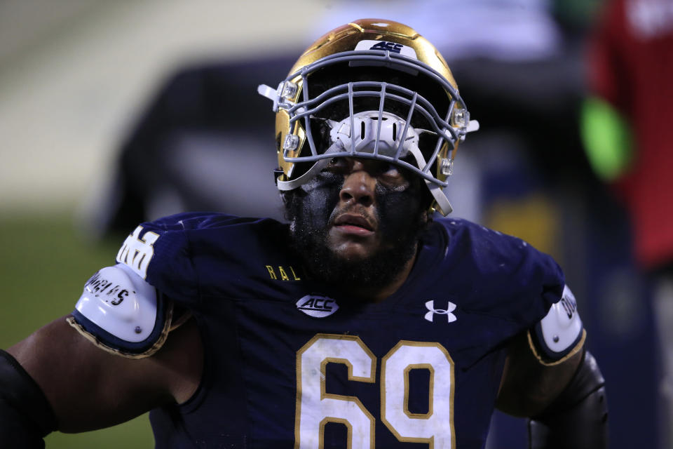 FILE - Notre Dame offensive lineman Aaron Banks (69) looks into the stands as he walks off the field following their loss to Clemson at the Atlantic Coast Conference championship NCAA college football game in Charlotte, N.C., in this Saturday, Dec. 19, 2020, file photo. Banks was selected to The Associated Press All-America first-team, Monday, Dec. 28, 2020. (AP Photo/Brian Blanco, File)
