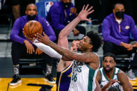 Boston Celtics' Marcus Smart (36) goes to the basket under pressure from Los Angeles Lakers' Marc Gasol (14) during the first half of an NBA basketball game Thursday, April 15, 2021, in Los Angeles. (AP Photo/Ringo H.W. Chiu)