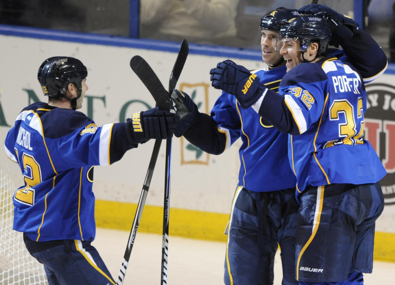 St. Louis Blues' Chris Porter (32) is congratulated on his goal against the San Jose Sharks by teammates Barret Jackman (5) and Scott Nichol (12) in the second period of an NHL hockey game Tuesday, March 12, 2013, in St. Louis. The Blues won 4-2.(AP Photo/Bill Boyce)