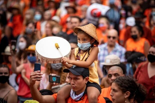 Thousands of people attend a 'Cancel Canada Day;' event at the Vancouver Art Gallery in support of First Nations communities across the country in Vancouver, British Columbia on Thursday, July 1, 2021.  (Ben Nelms/CBC - image credit)
