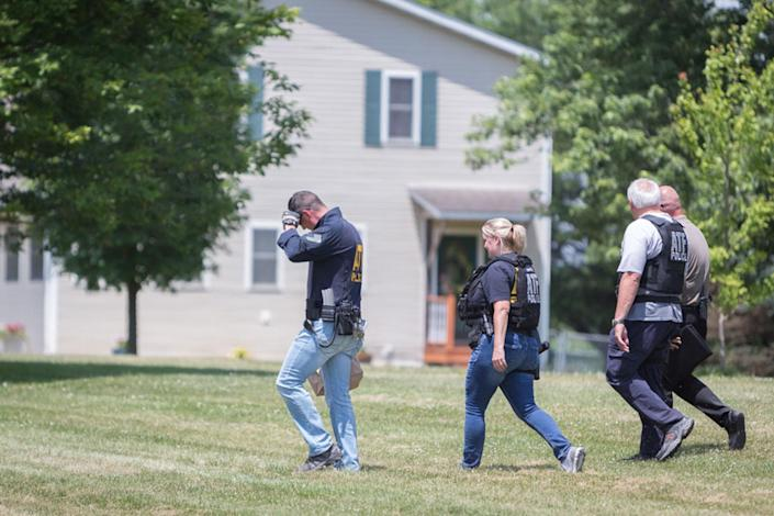 <p>Police investigators are seen outside the house of Virginia shooting suspect James Hodgkinson in Belleville, Ill., June 14, 2017. (Photo: Kenny Bahr/Reuters) </p>