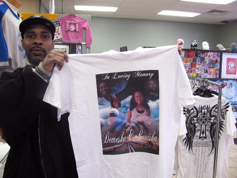 Clayton Carter, owner of Can You Picture This, holds a T-shirt made in memory of Demesha Hunt, 24, left, and Renisha Landers, 23, right, on Tuesday, Dec. 27, 2011, in Detroit. Hunts' and Landers' bodies were found Dec. 19, 2011, in a car trunk in Detroit. Police discovered the badly burned bodies of two other women on Sunday, Dec. 25, 2011, in a car trunk. Police have said three of the four women had promoted themselves as escorts through the same website.  (AP Photo/David Runk)