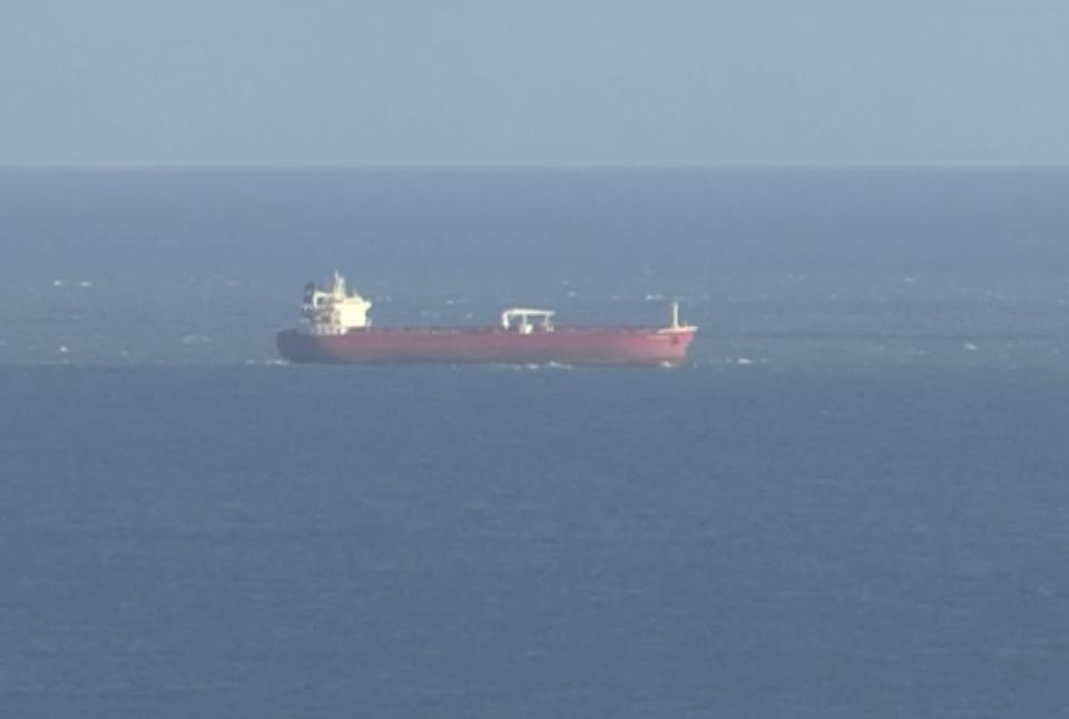 In this image taken from SKY video, shows a tanker at sea, as filmed from land on Sunday Oct. 25, 2020. British police are investigating an undisclosed incident aboard an oil tanker in the English Channel. The incident reportedly took place aboard the Libyan-registered oil tanker Nave Andromeda south of Sandown on Isle of Wight, according to Isle of Wight Radio. (SKY News via AP)