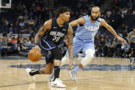 Orlando Magic's Markelle Fultz, left, drives against Minnesota Timberwolves' Jordan McLaughlin in the first half of an NBA basketball game, Friday, March 6, 2020, in Minneapolis. (AP Photo/Jim Mone)