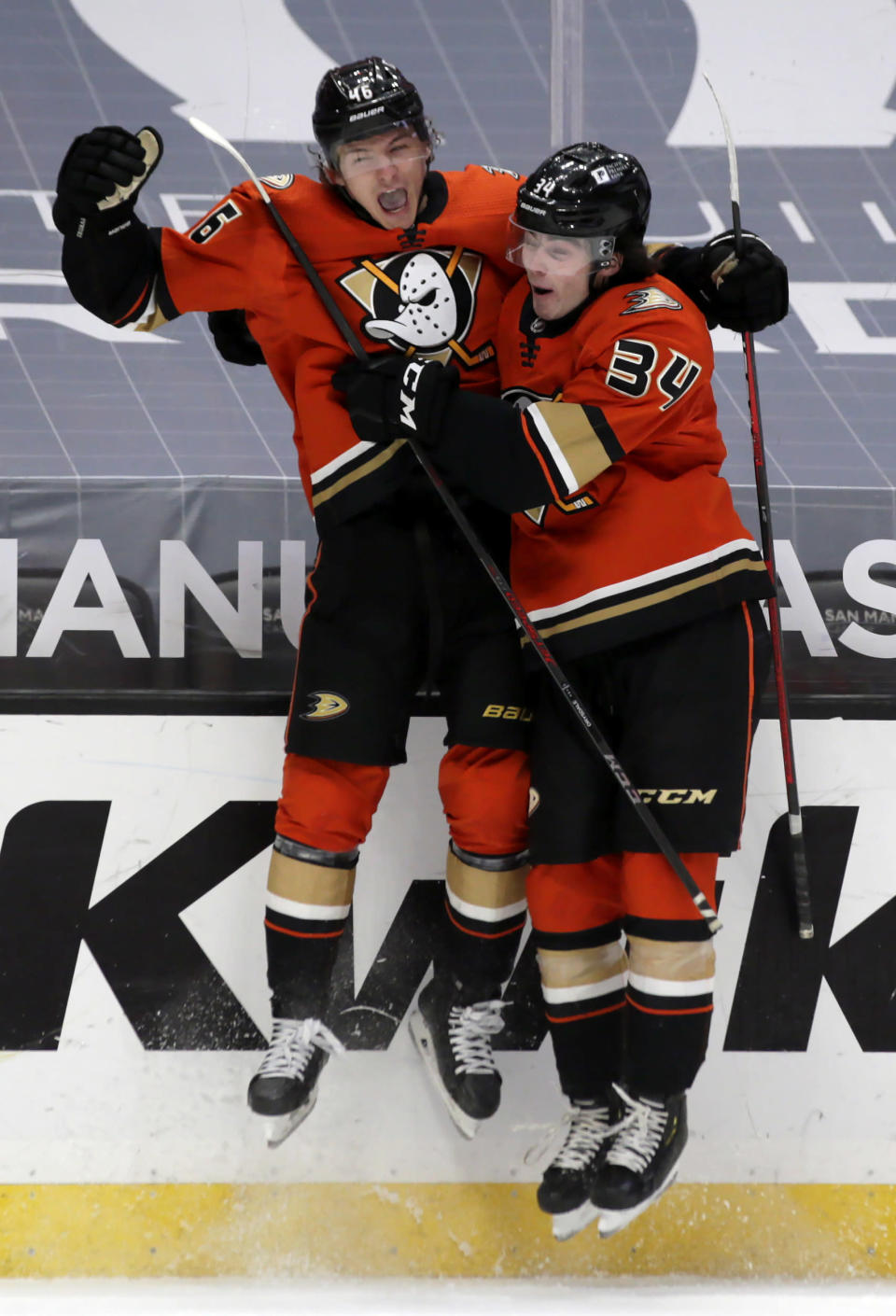 Anaheim Ducks center Trevor Zegras, left, celebrates with defenseman Jamie Drysdale after his first NHL goal, against the Arizona Coyotes during the second period of a hockey game in Anaheim, Calif., Thursday, March 18, 2021. (AP Photo/Alex Gallardo)