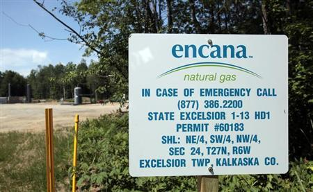 An Encana natural gas sign is seen near a production well for natural gas and oil in a state forest park in Kalkaska
