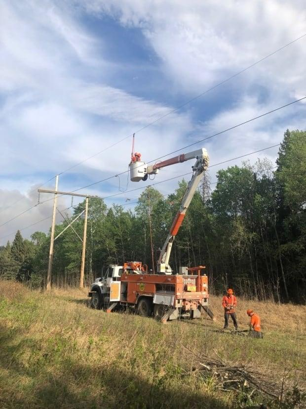 Many SaskPower customers in the north are only served by one transmission line. That line had 15 damaged power structures due to the wildfire this week, the Crown corporation says. (SaskPower - image credit)